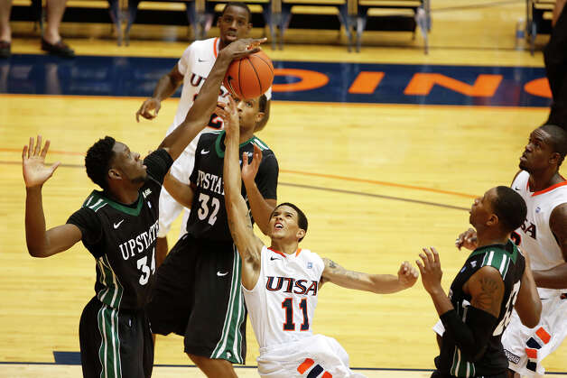 UTSA's Michael Hale III, center, has his shot blocked by South Carolina Upstate's Babatunde Olumuyiwa during second half action at UTSA's Convocation Center on Saturday, Nov. 17, 2012. UTSA won 67-59. MICHAEL MILLER / FOR THE EXPRESS-NEWS Photo: Michael Miller, Express-News / © San Antonio Express-News