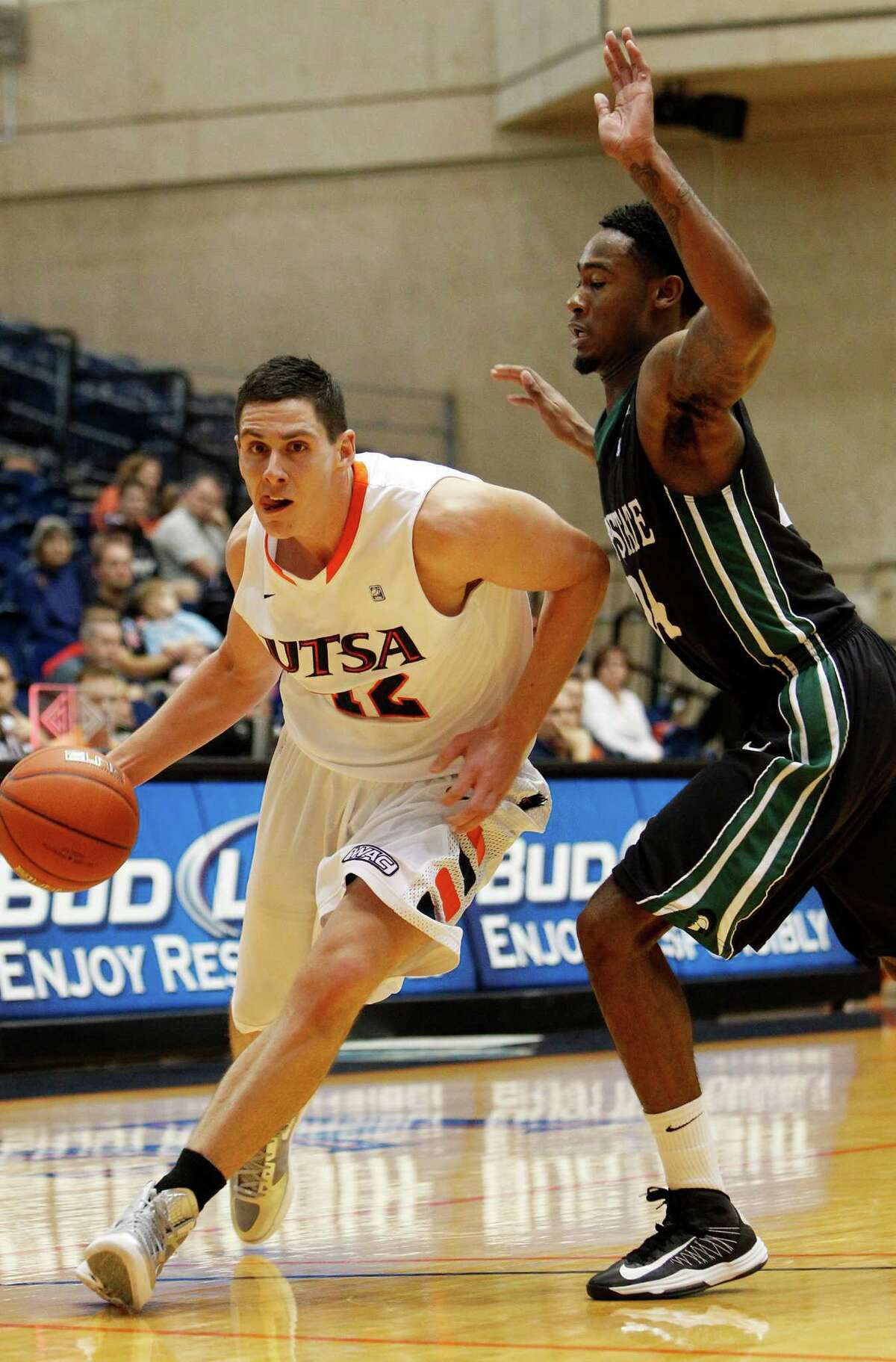 UTSA's Jeromie Hill, left, drives to the basket past the defense of South Carolina Upstate's Jodd Maxey during first half action at UTSA's Convocation Center on Saturday, Nov. 17, 2012. MICHAEL MILLER / FOR THE EXPRESS-NEWS