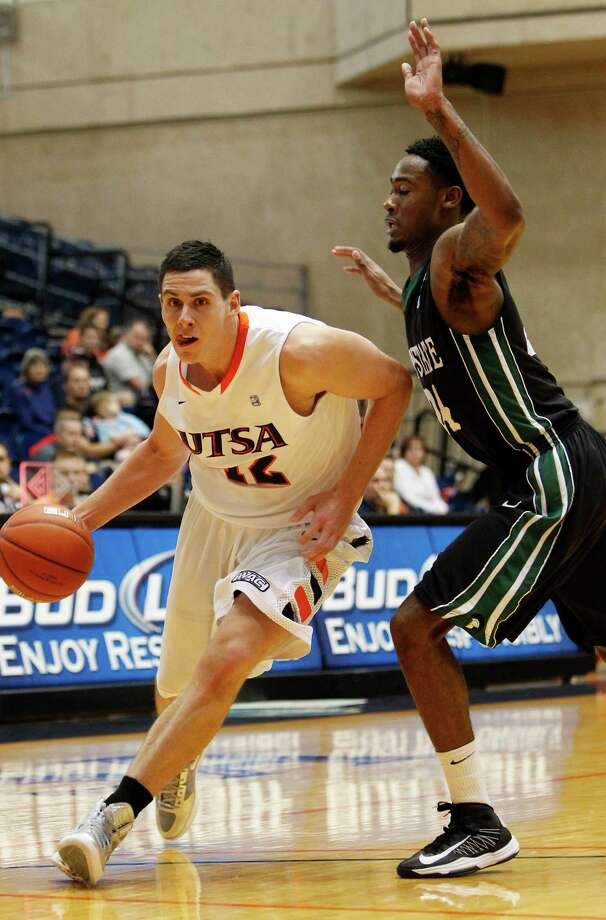 UTSA's Jeromie Hill, left, drives to the basket past the defense of South Carolina Upstate's Jodd Maxey during first half action at UTSA's Convocation Center on Saturday, Nov. 17, 2012. MICHAEL MILLER / FOR THE EXPRESS-NEWS Photo: Michael Miller, Express-News / © San Antonio Express-News