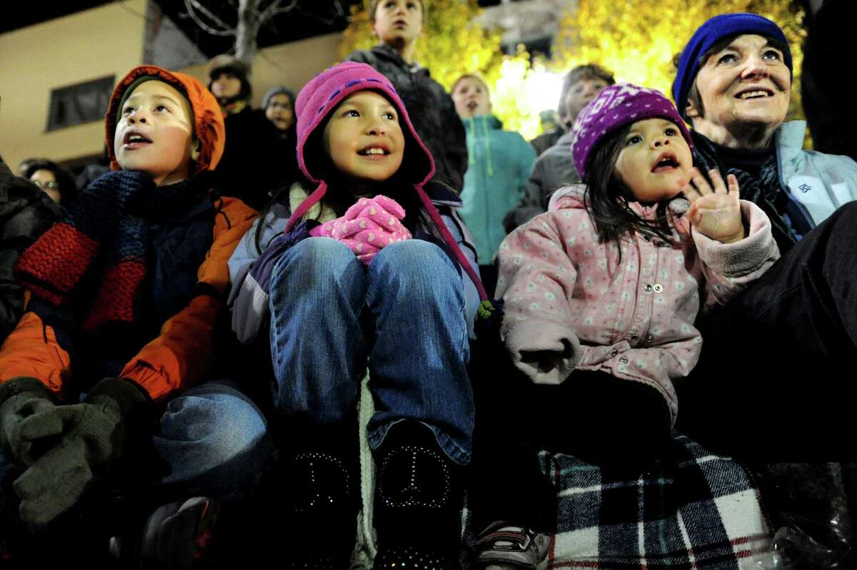 Ann Avery-Jones of Gloversville, right, watches the annual Gazette Holiday Parade with her grandchildren on Saturday, Nov. 17, 2012, in Schenectady, N.Y. The children, from left, are Carmelo Robinson, 9, Kirsten Draper, 8, and Lauren Draper, 3. (Cindy Schultz / Times Union)