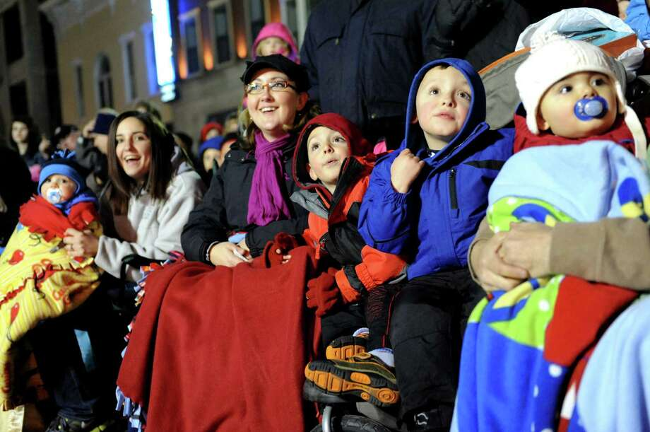 Families watch the annual Gazette Holiday Parade with her grandchildren on Saturday, Nov. 17, 2012, in Schenectady, N.Y. (Cindy Schultz / Times Union) Photo: Cindy Schultz / 00019795A
