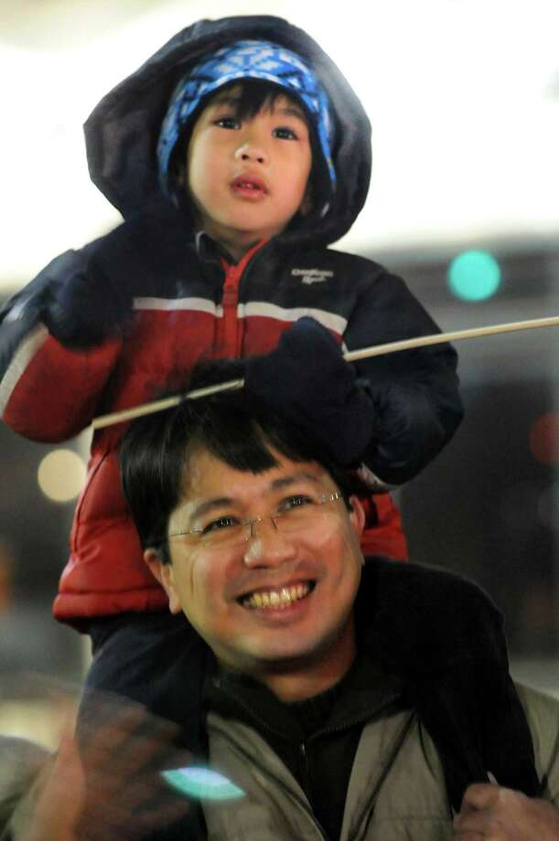 Rainier Zafra, 4, of Clifton Park watches the annual Gazette Holiday Parade from the shoulders of his father, Jon, on Saturday, Nov. 17, 2012, in Schenectady, N.Y. (Cindy Schultz / Times Union) Photo: Cindy Schultz / 00019795A
