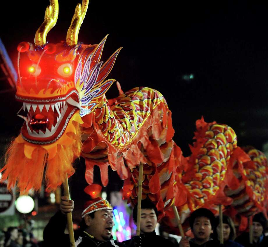 Members of the Chinese Martial Arts Academy move a Chinese dragon during the annual Gazette Holiday Parade on Saturday, Nov. 17, 2012, in Schenectady, N.Y. (Cindy Schultz / Times Union) Photo: Cindy Schultz / 00019795A