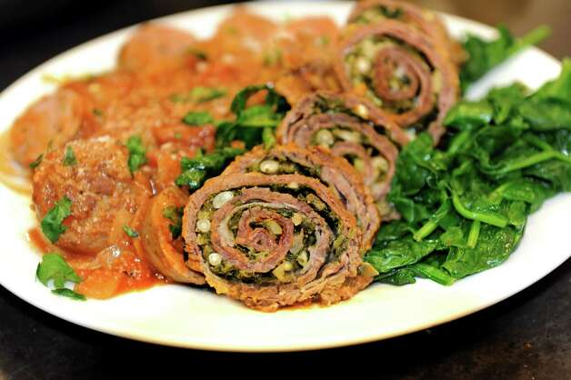 Randy Kramer's braciole al ragu over spinach and linguine during a cook-off on Saturday, Nov. 17, 2012, at Different Drummer's Kitchen in Guilderland, N.Y. Five finalists competed to have their dishes on the menu of Bellini's restaurant. (Cindy Schultz / Times Union) Photo: Cindy Schultz / 00020169A