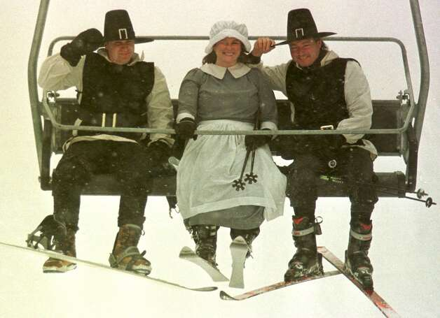 Three employees of the Sugarbush ski resort, from left,  Andrew Rubenstein, Anne Young and John Malony, dressed as pilgrims, ride the chairlift in Warren, Vt., Monday, Nov. 24, 1997.  Vermont ski areas are thankful for all the natural snow that's fallen in advance of the Thanksgiving holiday. It is expected to continue snowing until Thanksgiving.   (AP Photo/Toby Talbot) Photo: TOBY TALBOT / AP