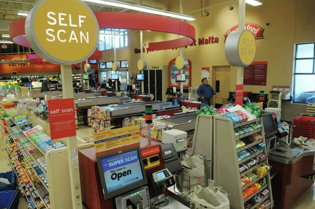 A view of the checkout lanes at the new Hannaford supermarket at  43 Round Lake Road on Thursday, May 17, 2012 in Malta, NY.  The grand opening of the store for the public will be on Saturday.   (Paul Buckowski / Times Union) Photo: Paul Buckowski / 00017737A