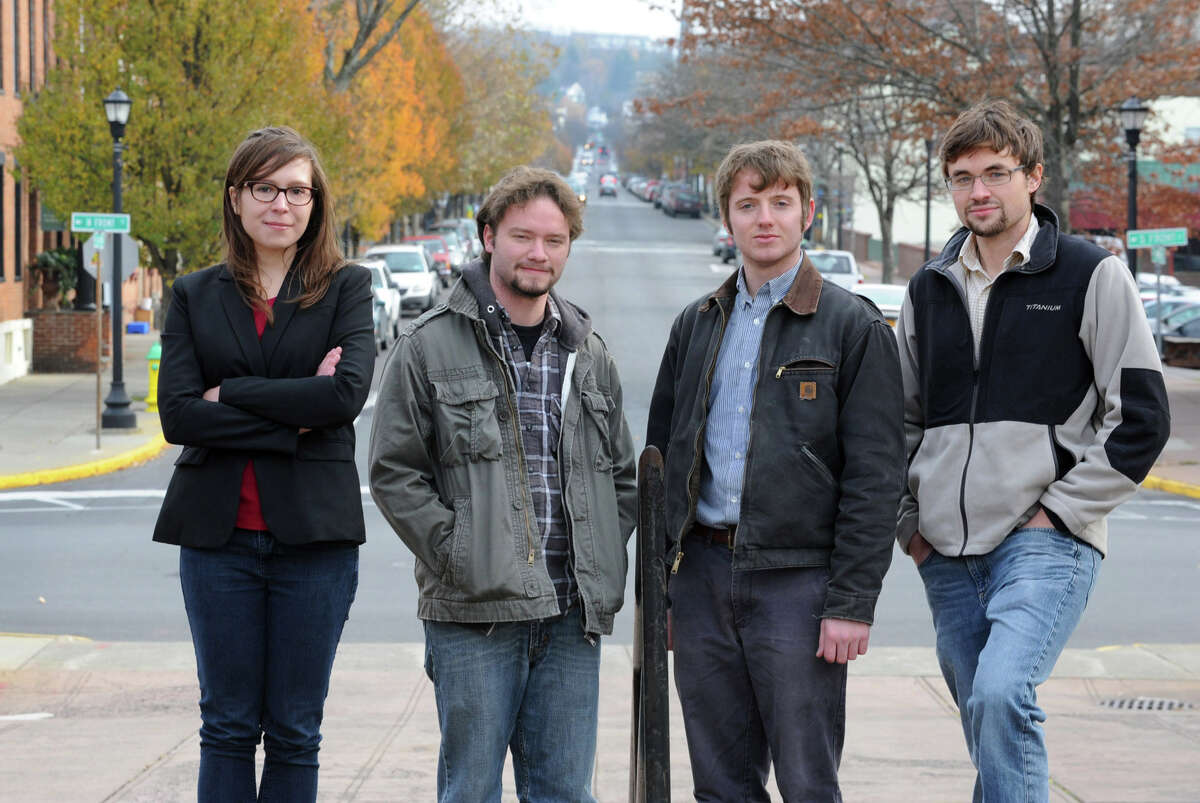 From left, Francesca Olsen, Tom Casey, Billy Shannon and Adam Shanks stand near the Hudson River at Promenade Hill on Friday, Nov. 16, 2012 in Hudson, N.Y. Tom Casey got fired from the Register Star and the other three left the newspaper also. (Lori Van Buren / Times Union)