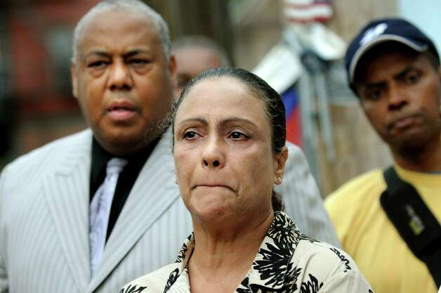 Ivette Cedres, mother of Luis Rivera, center, holds back tears as she and Ted Ward, NAACP president of the Schenectady chapter, left, attend a news conference on Thursday, Sept. 1, 2011, in Schenectady, N.Y. Schenectady police shot Rivera 14 times near the intersection of State and Grove streets. (Cindy Schultz / Times Union archive) Photo: Cindy Schultz / 00014485A