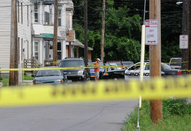 The scene where Luis Rivera was fatally shot at State Street and Grove Place in Schenectady, N.Y. Saturday Aug. 13, 2011.( Michael P. Farrell/Times Union archive) Photo: Michael P. Farrell