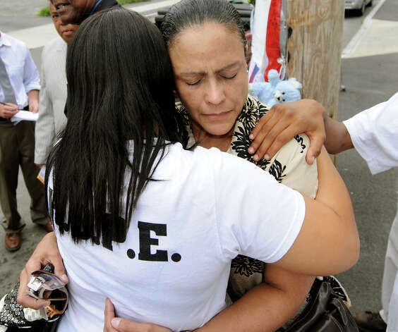 Ivette Cedres, mother of Luis Rivera, right, receives support from Treasure Clayton of Project H.O.P.E., left, after the NAACP holds a news conference on Thursday, Sept. 1, 2011, in Schenectady, N.Y. Schenectady police shot Rivera 14 times near the intersection of State and Grove streets. (Cindy Schultz / Times Union archive) Photo: Cindy Schultz
