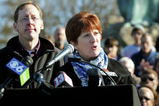 Kathy Sheehan, Albany city treasurer, center, announces she'll run for mayor during a news conference on Saturday, Nov. 17, 2012, at Washington Park in Albany, N.Y. Sheehan's husband, Bob, left, joins her. (Cindy Schultz / Times Union) Photo: Cindy Schultz / 00020129A