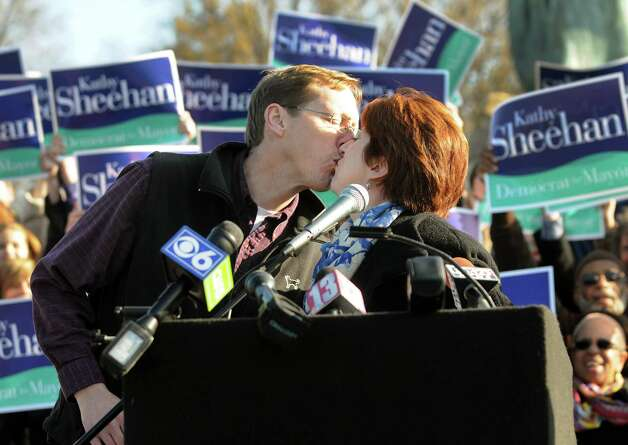 Kathy Sheehan, Albany city treasurer, right, receives a kiss from her husband, Bob, when she announces she'll run for mayor during a news conference on Saturday, Nov. 17, 2012, at Washington Park in Albany, N.Y. (Cindy Schultz / Times Union) Photo: Cindy Schultz / 00020129A