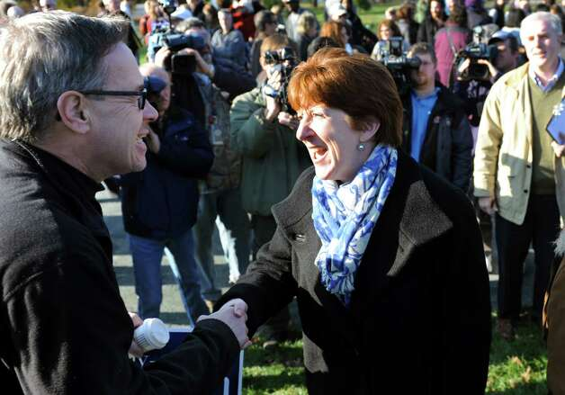 City resident Mark Bechard, left, congratulates Kathy Sheehan, center, after she announces she'll run for mayor on Saturday, Nov. 17, 2012, at Washington Park in Albany, N.Y. (Cindy Schultz / Times Union) Photo: Cindy Schultz / 00020129A