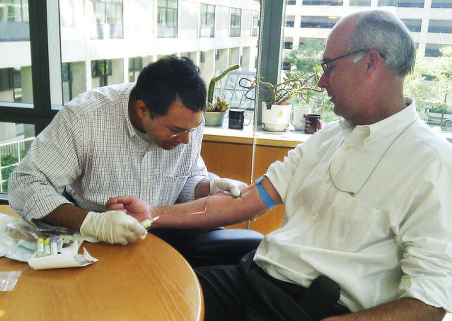 Bloomberg's John Lauerman has blood drawn. (Harvard Medical School)
