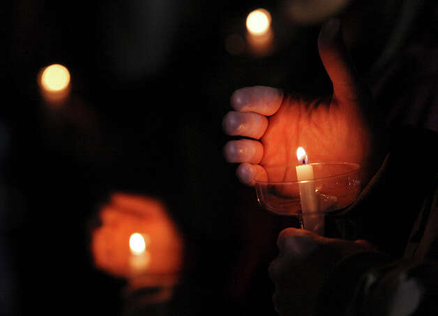 People attend a candlelight vigil held at Centennial Plaza in downtown Midland, Tx., Saturday Nov. 17, 2012. The vigil was held to remember people involved in an accident where a Union Pacific train struck a float carrying military veterans,Thursday Nov. 15, 2012, killing four men, including one from the San Antonio area. Photo: Edward A. Ornelas, San Antonio Express-News / © 2012 San Antonio Express-News