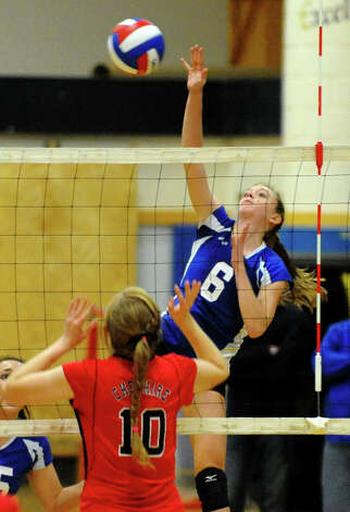 Darien's #6 Kelly Kosnik spikes the ball over the net to Cheshire, during Class LL girls volleyball championship action action in East Haven, Conn. on Saturday November 17, 2012. Photo: Christian Abraham / Connecticut Post