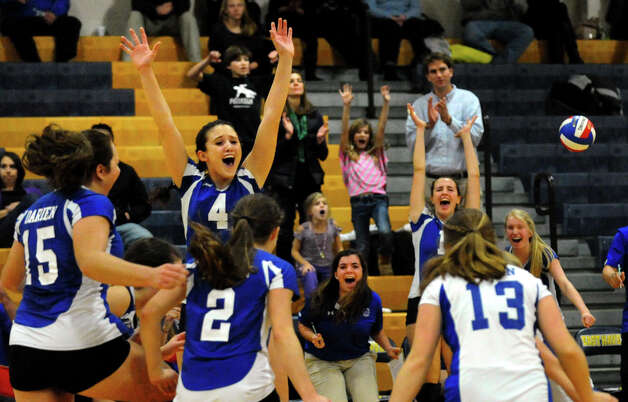Darien celebrates its win over Cheshire, during Class LL girls volleyball championship action action in East Haven, Conn. on Saturday November 17, 2012. Photo: Christian Abraham / Connecticut Post