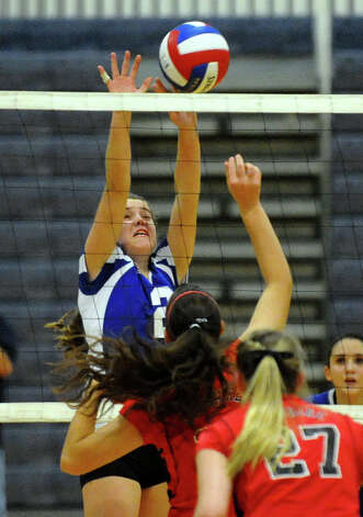 Darien's #2 Kathleen Burke blocks a Cheshire shot, during Class LL girls volleyball championship action action in East Haven, Conn. on Saturday November 17, 2012. Photo: Christian Abraham / Connecticut Post