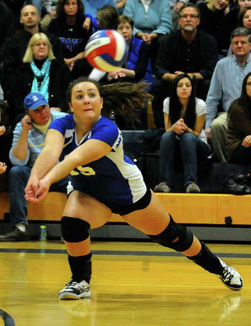 Darien's #15 Brittany Osborn reaches in to return the ball, during Class LL girls volleyball championship action action against Cheshire in East Haven, Conn. on Saturday November 17, 2012. Photo: Christian Abraham / Connecticut Post