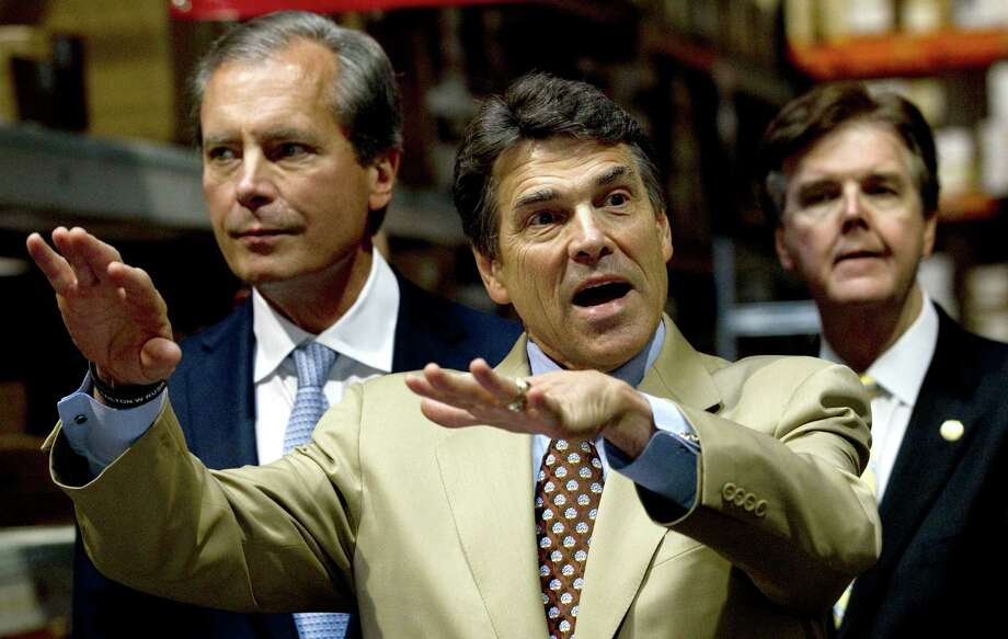 Lt. Gov. David Dewhurst, left, Gov. Rick Perry and state Sen. Dan Patrick held a September news conference devoted to stricter spending limits in Texas. Photo: Brett Coomer, Houston Chronicle / © 2012 Houston Chronicle