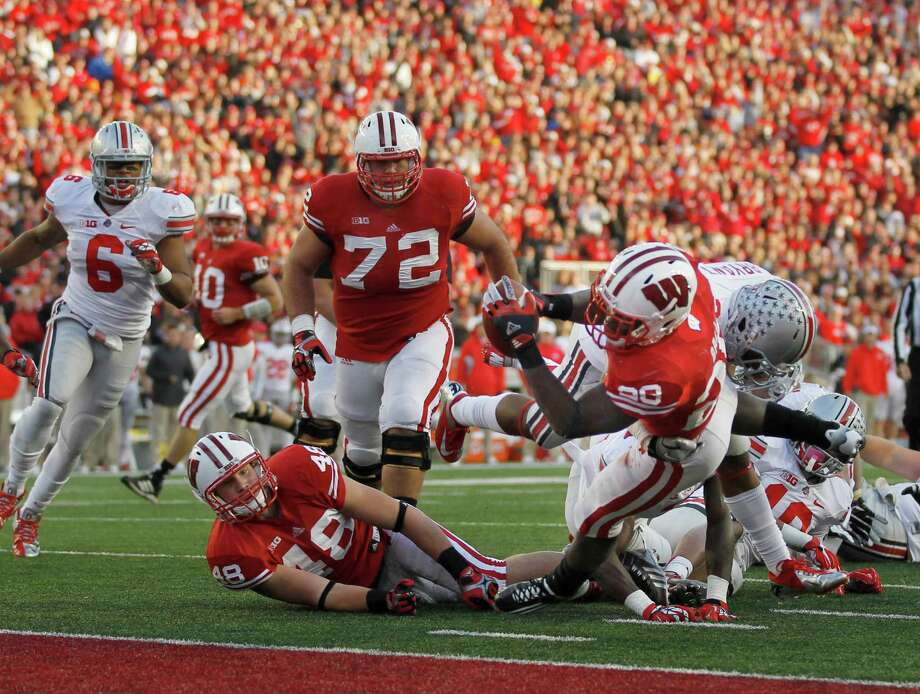 Wisconsin's Montee Ball scores a touchdown in the second quarter against Ohio State at Camp Randall Stadium on Saturday, November 17, 2012, in Madison, Wisconsin. (Rick Wood/Milwaukee Journal Sentinel/MCT) Photo: Rick Wood, McClatchy-Tribune News Service / Milwaukee Journal Sentinel