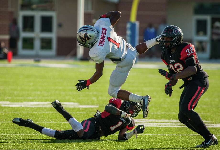 Manvel wide receiver Carlos Thompson (1) goes airborne after making a catch and being hit by Port Arthur Memorial's Jalen Barnes (1) in the fourth quarter. Photo: Andrew Richardson, Freelance / © 2012 Andrew Richardson