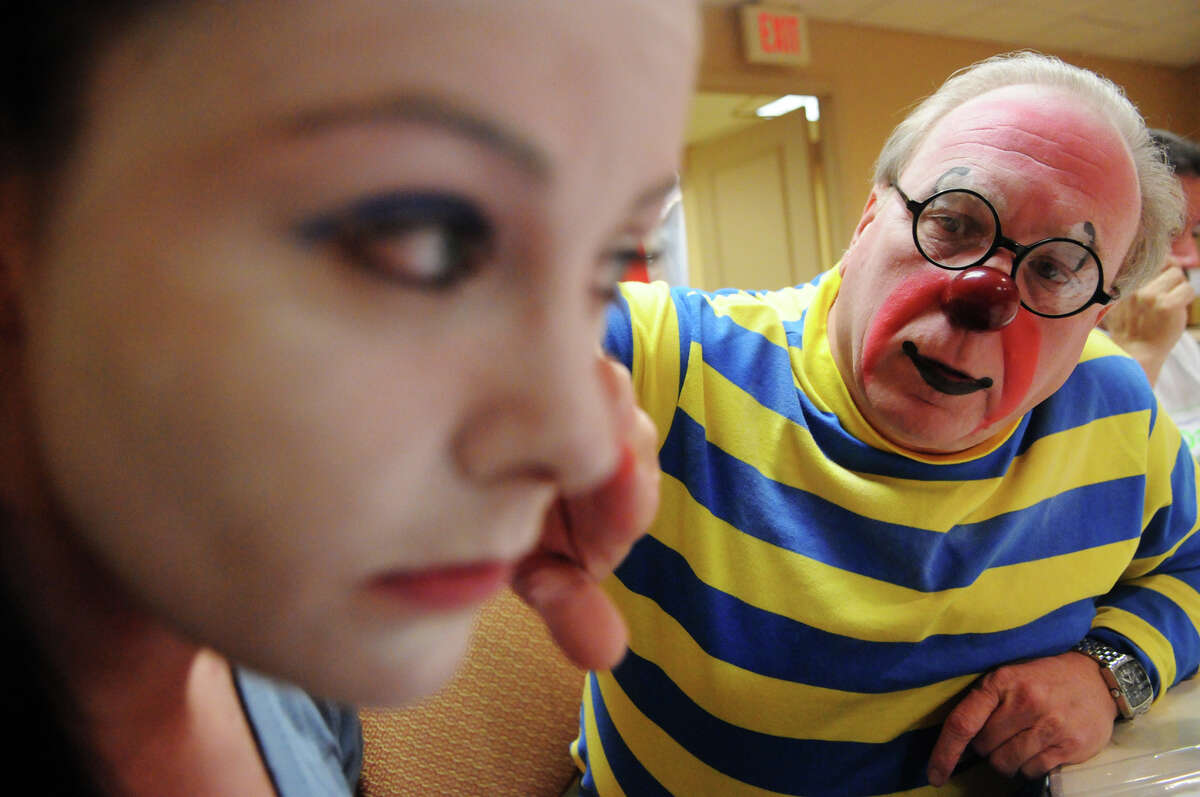 Professional clown Leo Desilets helps Advocate writer Maggie Gordon with her makeup during week two of clown college at the Stamford Marriott in Stamford, Conn., Nov. 14, 2012. Gordon will be a clown during the USB balloon parade Sunday.