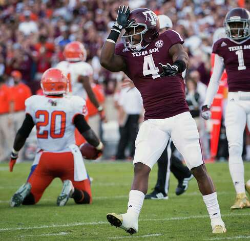 Texas A&M defensive back Toney Hurd Jr. (4) celebrates after a stop on Sam Houston State running back Tim Flanders (20) during the first half of a college football game at Kyle Field, Saturday, Nov. 17, 2012, in College Station. Photo: Smiley N. Pool, Houston Chronicle / © 2012  Houston Chronicle