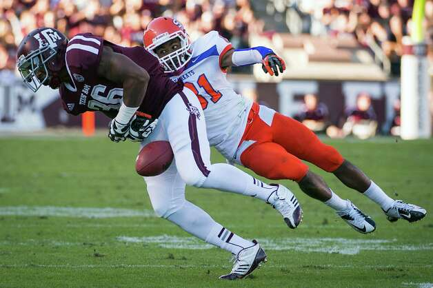 Texas A&M linebacker Donnie Baggs (36) fumbles the ball after an interception as Sam Houston State wide receiver Chance Nelson (81) hit him during the first half of a college football game at Kyle Field, Saturday, Nov. 17, 2012, in College Station. Texas A&M recovered the fumble. Photo: Smiley N. Pool, Houston Chronicle / © 2012  Houston Chronicle