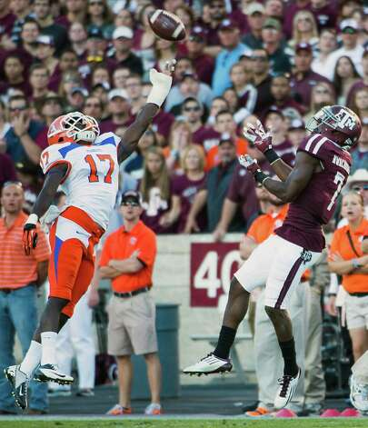 Texas A&M wide receiver Uzoma Nwachukwu (7) makes a catch as Sam Houston State cornerback Bookie Sneed (17) defends during the first half of a college football game at Kyle Field, Saturday, Nov. 17, 2012, in College Station. Photo: Smiley N. Pool, Houston Chronicle / © 2012  Houston Chronicle