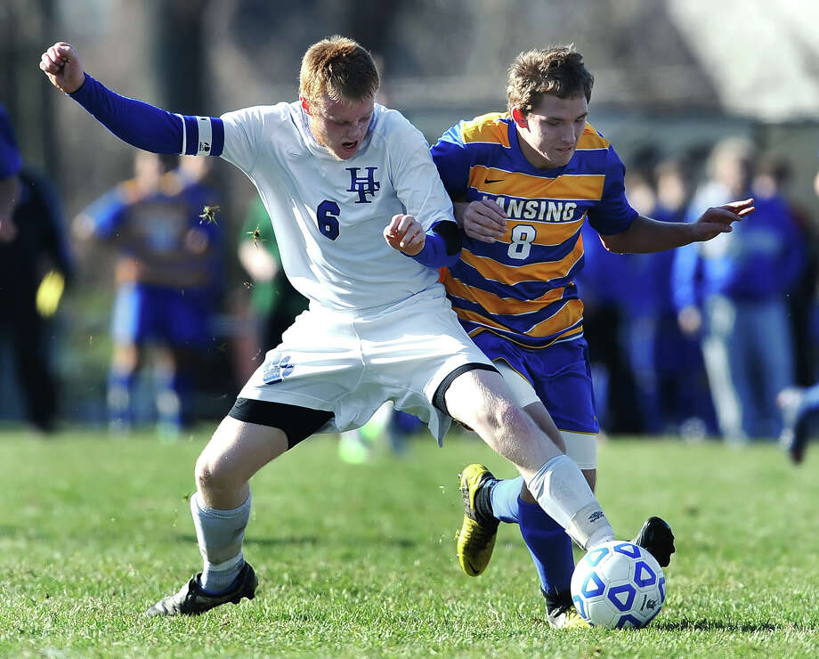 Hoosick Falls' Cody Gaines, left,  shields the ball from Lansing's Nate McIntosh during Class C NYSPHSAA Boys Soccer Championship semifinal played on Saturday, November 17, 2012 at Middletown High School.  Hoosick Falls lost to Lansing (Section 4), 1-0.  (Adrian Kraus / Special to the Times Union) Photo: Adrian Kraus / © akoPhoto 2011