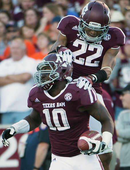 Texas A&M linebacker Sean Porter (10) celebrates with defensive back Dustin Harris (22) after recove