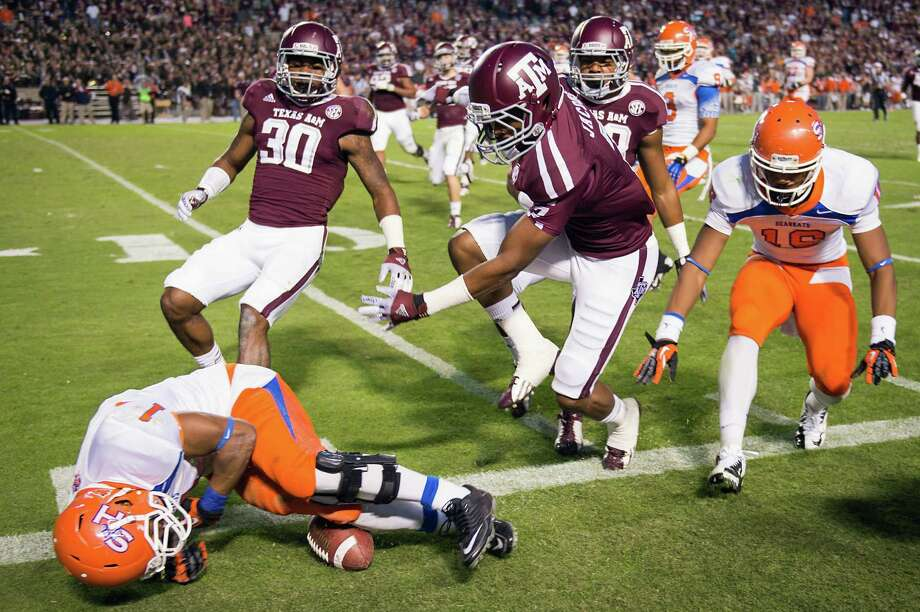 Sam Houston State running back Ridgeway Frank (1) fumbles the ball out of bounds as he is forced out by Texas A&M defensive back Tramain Jacobs (7) during the second half of a college football game at Kyle Field, Saturday, Nov. 17, 2012, in College Station. Photo: Smiley N. Pool, Houston Chronicle / © 2012  Houston Chronicle