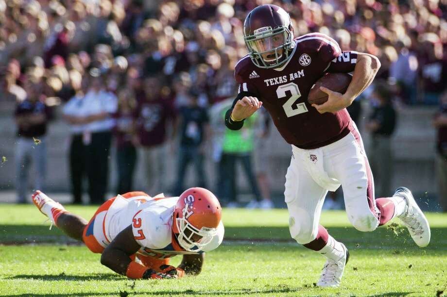 Texas A&M quarterback Johnny Manziel (2) scrambles past Sam Houston State defensive back Mike Littleton (27) during the first half of a college football game at Kyle Field, Saturday, Nov. 17, 2012, in College Station. Photo: Smiley N. Pool, Houston Chronicle / © 2012  Houston Chronicle