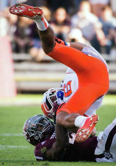 Sam Houston State wide receiver Richard Sincere (6) is dragged down by Texas A&M defensive back Stev