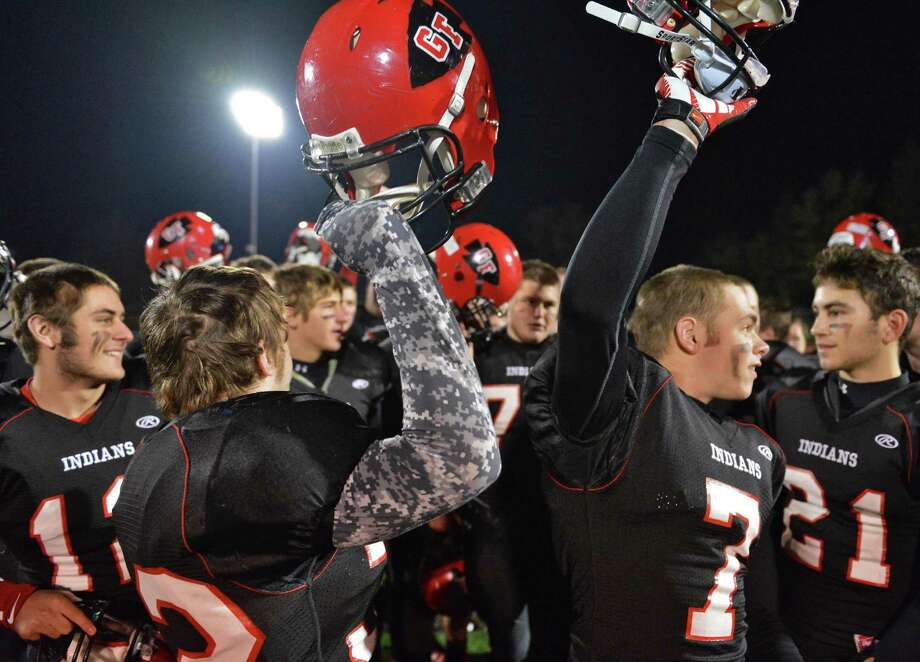 Glens Falls teammates celebrate their win over Marlboro High of the Class B state semifinal football game at Dietz Stadium in Kingston Saturday Nov. 17, 2012.  (John Carl D'Annibale / Times Union) Photo: John Carl D'Annibale / 00020088A