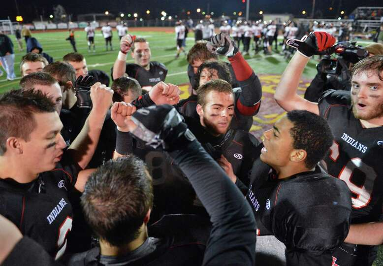 Glens Falls teammates celebrate their win over Marlboro High of the Class B state semifinal football