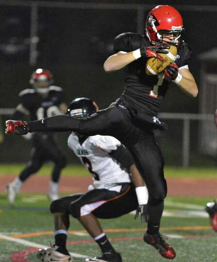 Glens Falls' #1 Jake Dailey intercepts a pass meant for Marlboro High's #3 Devin Pierre during the C