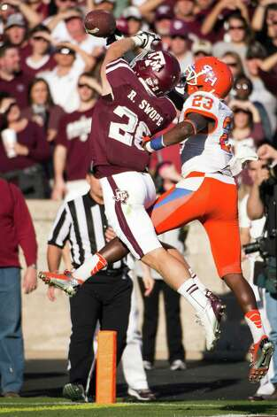 Texas A&M wide receiver Ryan Swope (25) can't catch a pass as Sam Houston State defensive back Robert Shaw (23) defends during the first half of a college football game at Kyle Field, Saturday, Nov. 17, 2012, in College Station. Photo: Smiley N. Pool, Houston Chronicle / © 2012  Houston Chronicle