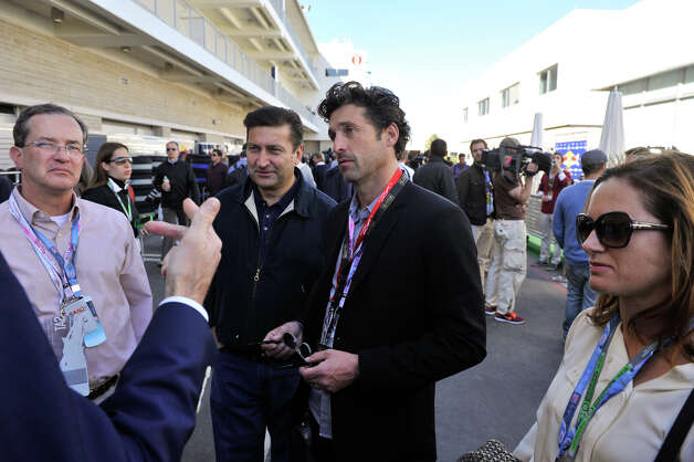 Actor Patrick Dempsey (center) talks with friends in the paddock Saturday at the Circuit of the America's in Austin. Photo:  Robin Jerstad/For The Express-News