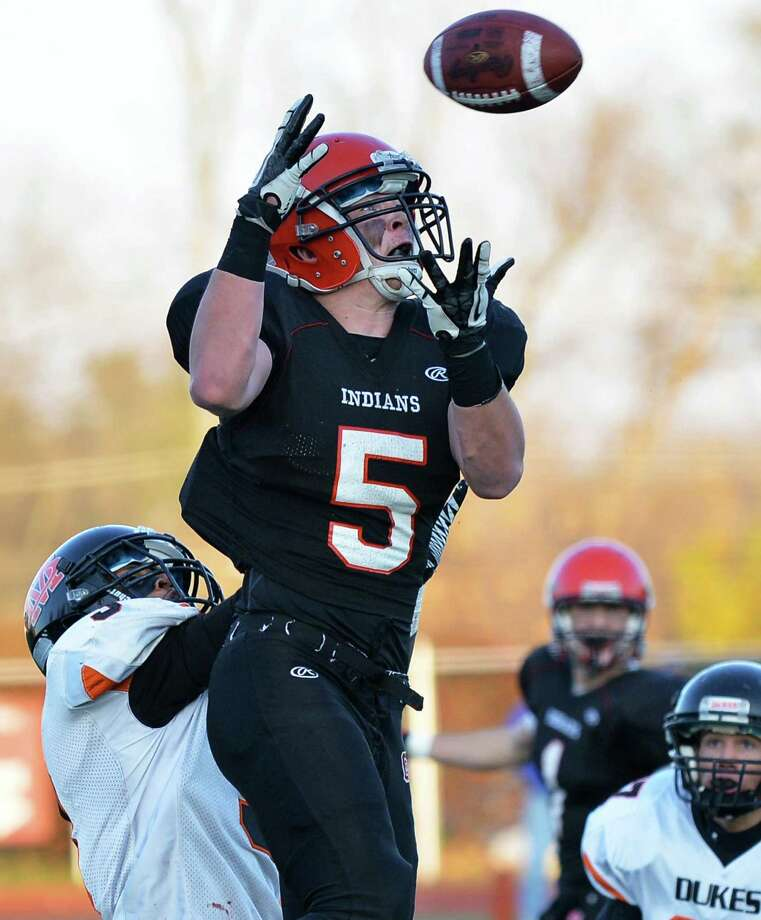 Glens Falls' #5 Mike Lanoir rises above Marlboro defenders during the Class B state semifinal football game at Dietz Stadium in Kingston Saturday Nov. 17, 2012.  (John Carl D'Annibale / Times Union) Photo: John Carl D'Annibale / 00020088A