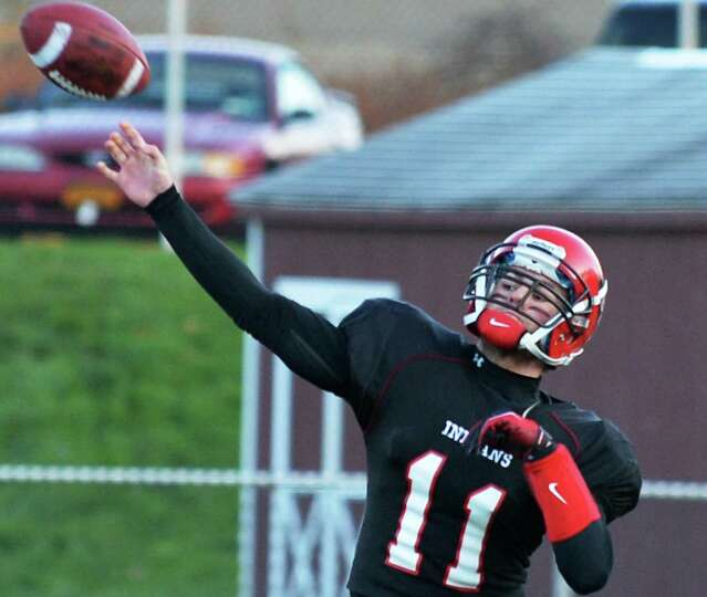 Glens Falls quarterback Cam Girard lets one fly against Marlboro High during the Class B state semif