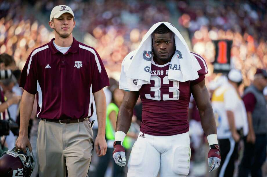 Texas A&M running back Christine Michael (33) leaves the field after being ejected during the first half of a college football game at Kyle Field, Saturday, Nov. 17, 2012, in College Station. Photo: Smiley N. Pool, Houston Chronicle / © 2012  Houston Chronicle