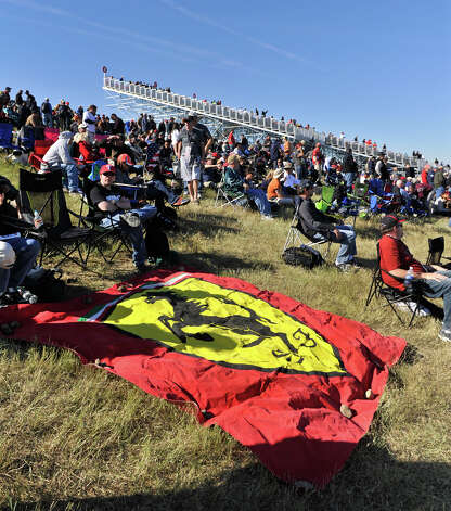 Fans display their support for the Ferrari team Saturday at the Circuit of the America's in Austin. Photo:  Robin Jerstad/For The Express-News