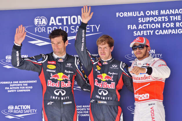 Driver Mark Webber, Sebastian Vettel, and Lewis Hamilton wave to the crowd following qualifying Saturday at the Circuit of the America's in Austin. Vettel will start on the pole for the US Grand Prix at the Circuit Sunday. Photo:  Robin Jerstad/For The Express-News