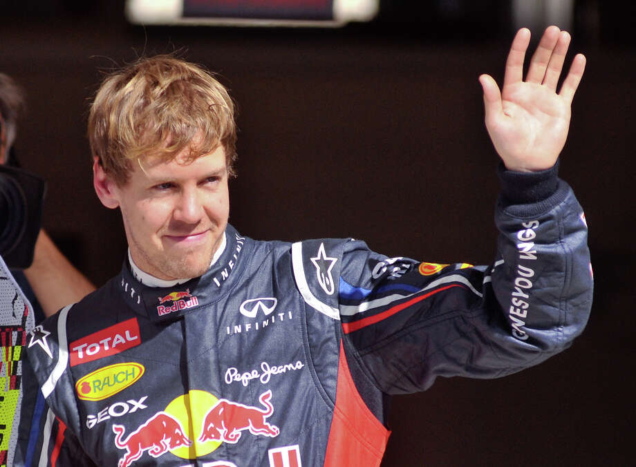 Sebastian Vettel acknowedges the crowd after winning the pole position for the US Grand Prix Saturday at the Circuit of the America's in Austin. Photo:  Robin Jerstad/For The Express-News