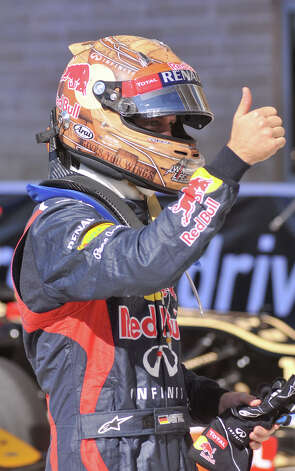 Sebatian Vettel gives a thumbs up after winning the pole for the United States Grand Prix Saturday at the Circuit of the America's in Austin. Photo:  Robin Jerstad/For The Express-News