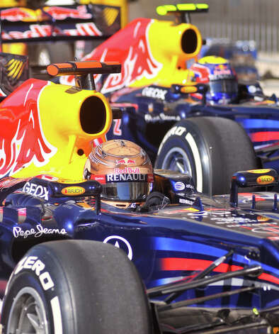 Sebastian Vettel and teammate Mark Webber pull into the pits after qualifying Saturday at the Circuit of the America's in Austin. Photo:  Robin Jerstad/For The Express-News