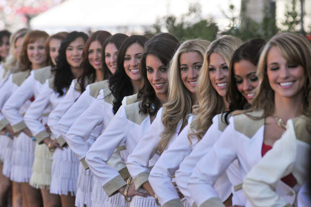 Grid Girls for the United States Grand Prix pose Saturday at the Circuit of the America's in Austin. Photo:  Robin Jerstad/For The Express-News