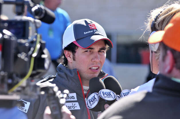 Mexican driver Sergio Perez talks to the media after qualifying Saturday at the Circuit of the America's in Austin. Photo:  Robin Jerstad/For The Express-News